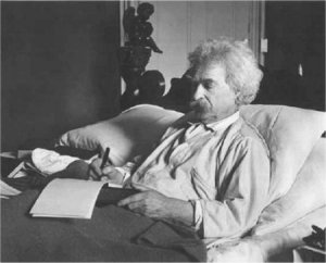 Mark Twain in bed